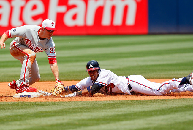 ATLANTA - MAY 31:  Yunel Escobar #19 of the Atlanta Braves is tagged out at second base by Chase Utley #26 of the Philadelphia Phillies in the third inning at Turner Field on May 31, 2010 in Atlanta, Georgia.  (Photo by Kevin C. Cox/Getty Images)