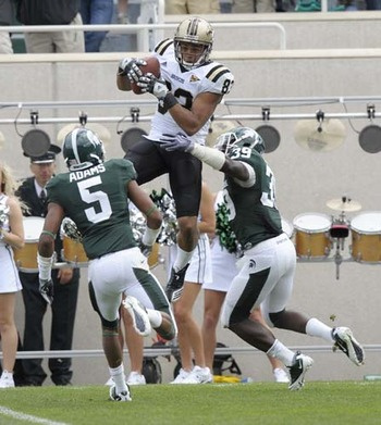 Jordan White leaps over Michigan State defenders to make the catch.