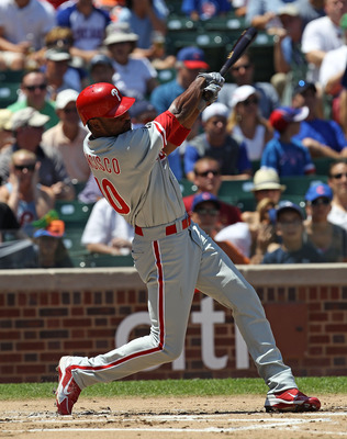 CHICAGO - JULY 16: Ben Francisco #10 of the Philadelphia Phillies hits the ball against the Chicago Cubs at Wrigley Field on July 16, 2010 in Chicago, Illinois. The Cubs defeated the Phillies 4-3. (Photo by Jonathan Daniel/Getty Images)