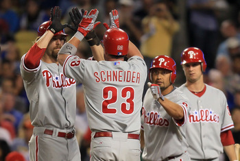 LOS ANGELES, CA - AUGUST 31:  (L-R) Jayson Werth #28, Brian Schneider #23 and Shane Victorino #8 of the Philadelphia Phillies celebrate Schneider's three-run home run in the second inning against the Los Angeles Dodgers at Dodger Stadium on August 31, 201