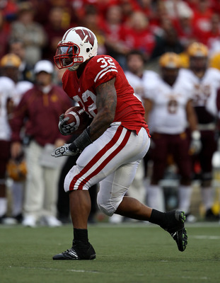 MADISON, WI - SEPTEMBER 18: John Clay #32 of the Wisconsin Badgers runs for a first down against the Arizona State Sun Devils at Camp Randall Stadium on September 18, 2010 in Madison, Wisconsin. Wisconsin defeated Arizona State 20-19. (Photo by Jonathan D