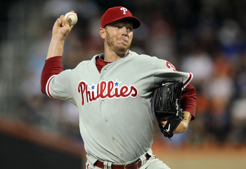 NEW YORK - AUGUST 14:  Roy Halladay #34 of the Philadelphia Phillies delivers a pitch against the New York Mets on August 14, 2010 at Citi Field in the Flushing neighborhood of the Queens borough of New York City.  (Photo by Jim McIsaac/Getty Images)