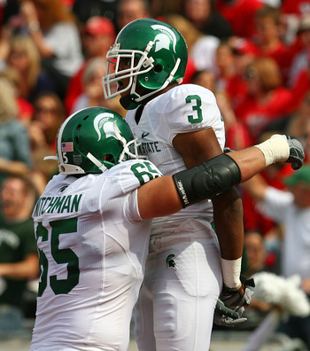MADISON, WI - SEPTEMBER 26: B.J. Cunningham #3 of the Michigan State Spartans celebrates a touchdown catch with teammate Joel Nitchman #65 against the Wisconsin Badgers on September 26, 2009 at Camp Randall Stadium in Madison, Wisconsin. Wisconsin defeate