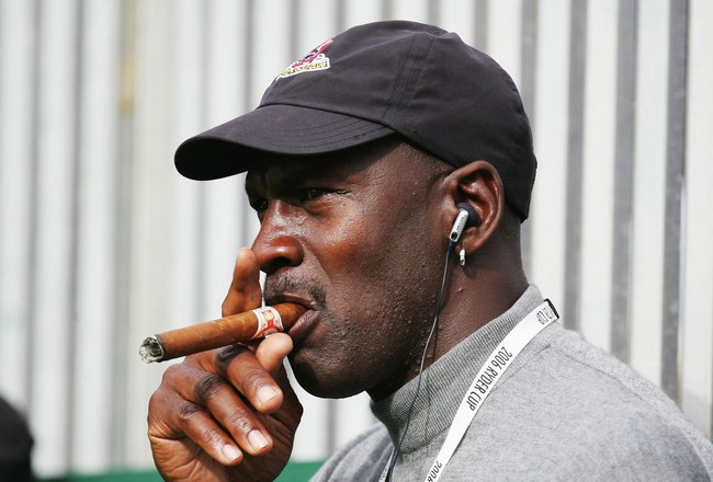 KILDARE, IRELAND - SEPTEMBER 22:  Michael Jordan smokes a cigar and watches the action during the morning fourballs of the first day of the 2006 Ryder Cup at The K Club on September 22, 2006 in Straffan, Co. Kildare, Ireland.  (Photo by Ross Kinnaird/Gett