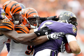 Geno Atkins and Michael Johnson get a sack