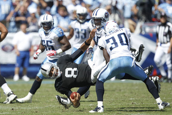 NASHVILLE - SEPTEMBER 12: Jason Campbell #8 of the Oakland Raiders gets tackled by Jason McCourty #30 of the Tennessee Titans during the NFL season opener at LP Field on September 12, 2010 in Nashville, Tennessee. The Titans defeated the Raiders 38-13. (P