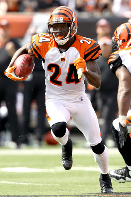 CINCINNATI - SEPTEMBER 19:  Cornerback Adam Jones #24 of the Cincinnati Bengals carries the ball after intercepting a pass against the Baltimore Ravens at Paul Brown Stadium on September 19, 2010 in Cincinnati, Ohio.  (Photo by Matthew Stockman/Getty Imag