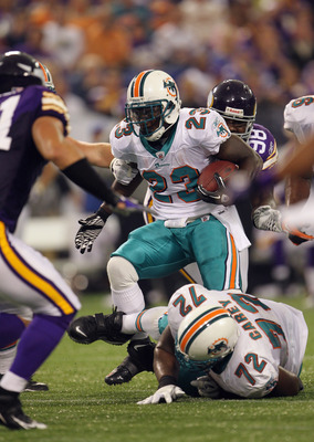 MINNEAPOLIS - SEPTEMBER 19:  Ronnie Brown #23 of the Miami Dolphins carries the ball during the game against the Minnesota Vikings on September 19, 2010 at Hubert H. Humphrey Metrodome in Minneapolis, Minnesota.  (Photo by Jamie Squire/Getty Images)