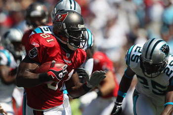 CHARLOTTE, NC - SEPTEMBER 19:  Michael Spurlock #81 of the Tampa Bay Buccaneers runs with the ball against the defense of the Carolina Panthers during their game at Bank of America Stadium on September 19, 2010 in Charlotte, North Carolina.  (Photo by Str