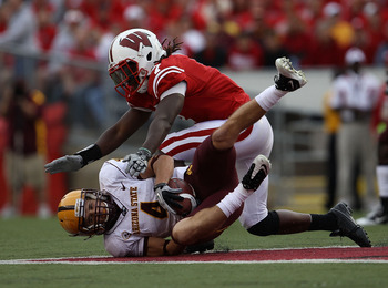 MADISON, WI - SEPTEMBER 18: Aaron Pflugrad #4 of the Arizona State Sun Devils catches a pass on the ground under pressure from Aaron Henry #7 of the Wisconsin Badgers at Camp Randall Stadium on September 18, 2010 in Madison, Wisconsin. Wisconsin defeated