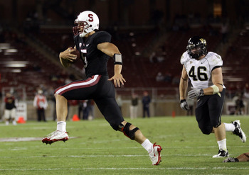 PALO ALTO, CA - SEPTEMBER 18:  Alex Loukas #5 of the Stanford Cardinal runs past Matt Woodlief #46 of the Wake Forest Demon Deacons to score a touchdown at Stanford Stadium on September 18, 2010 in Palo Alto, California.  (Photo by Ezra Shaw/Getty Images)