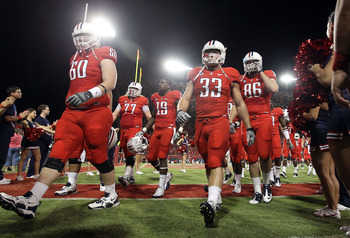 TUCSON, AZ - SEPTEMBER 18:  (L-R) Carter Lees #60, Jake Fischer #33 and Jack Baucus #86 of the Arizona Wildcats walk off the field after warm ups to the college football game against the Iowa Hawkeyes at Arizona Stadium on September 18, 2010 in Tucson, Ar