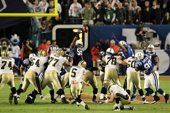 MIAMI GARDENS, FL - FEBRUARY 07: Garrett Hartley #5 of the New Orleans Saints kicks a field goal as Mark Brunell #11 holds against the Indianapolis Colts during Super Bowl XLIV on February 7, 2010 at Sun Life Stadium in Miami Gardens, Florida.  (Photo by