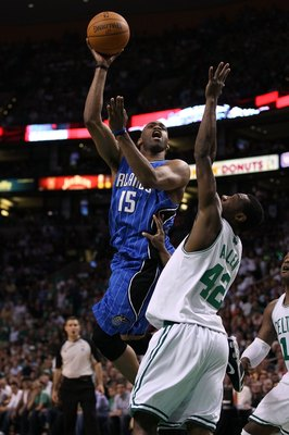 BOSTON - MAY 28:  Vince Carter #15 of the Orlando Magic attempts a shot against Tony Allen #42 of the Boston Celtics in Game Six of the Eastern Conference Finals during the 2010 NBA Playoffs at TD Garden on May 28, 2010 in Boston, Massachusetts.  NOTE TO