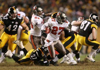PITTSBURGH - DECEMBER 3:   Torrie Cox #27 of the Tampa Bay Buccaneers is tackled by Anthony Smith #27 of the Pittsburgh Steelers at Heinz Field on December 3, 2006 in Pittsburgh, Pennsylvania.  (Photo by Nick Laham/Getty Images)