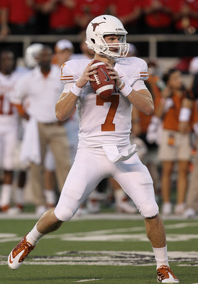 LUBBOCK, TX - SEPTEMBER 18:  Quarterback Garrett Gilbert #7 of the Texas Longhorns looks to pass against the Texas Tech Red Raiders at Jones AT&T Stadium on September 18, 2010 in Lubbock, Texas.  (Photo by Ronald Martinez/Getty Images)