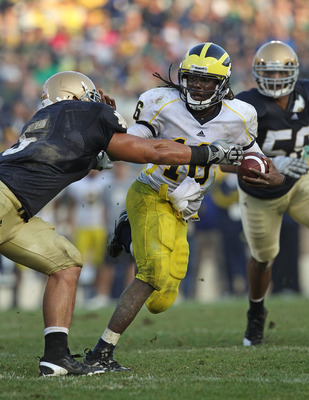 Denard Robinson stiff-arming the entire Notre Dame defense.