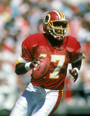 1987: Doug Williams #17 of the Washington Redskins moves back to pass during a 1987 NFL season game. (Photo by: Scott Cunningham/Getty Images)
