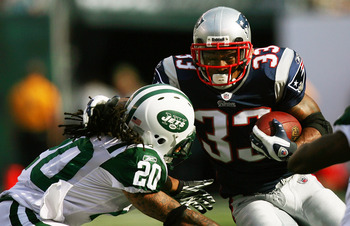 EAST RUTHERFORD, NJ - SEPTEMBER 19:  Kyle Wilson #20 of the New York Jets attempts to tackle Kevin Faulk #33 of the New England Patriots during the first quarter at the New Meadowlands Stadium on September 19, 2010 in East Rutherford, New Jersey.  (Photo