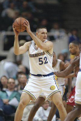 26 Nov 1996:  Center Todd Fuller of the Golden State Warriors holds the ball during a game against the Miami Heat at the San Jose Arena in San Jose, California.  The Heat won the game 107-88. Mandatory Credit: Otto Greule  /Allsport