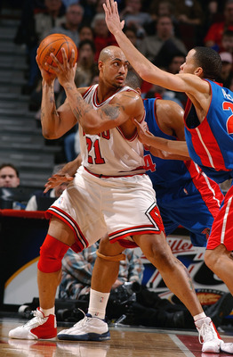 CHICAGO - FEBRUARY 25:  Marcus Fizer #21 of the Chicago Bulls posts up Tayshaun Prince #22 of the Detroit Pistons during a game on February 25, 2004 at the United Center in Chicago, Illinois. The Pistons won 107-88. NOTE TO USER: User expressly acknowledg