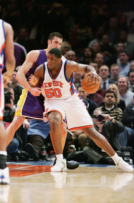 NEW YORK - FEBRUARY 28:  Michael Sweetney #50 of the New York Knicks moves the ball against Chris Mihm #31 of the Los Angeles Lakers during the game on February 28, 2005 at Madison Square Garden in New York City.  The Knicks won 117-115.  NOTE TO USER:  U