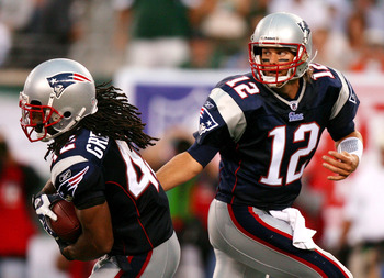 EAST RUTHERFORD, NJ - SEPTEMBER 19:  Tom Brady #12 of the New England Patriots hands the ball off to BenJarvus Green-Ellis #42 during a game against the New York Jets at the New Meadowlands Stadium on September 19, 2010 in East Rutherford, New Jersey. The