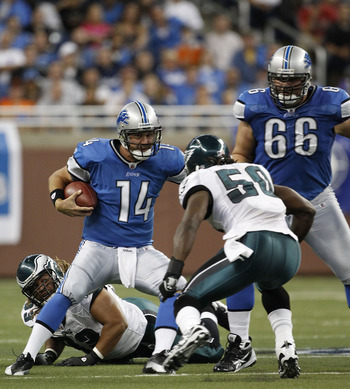 DETROIT - SEPTEMBER 19:  Shaun Hill #14 of the Detroit Lions is sacked by Ernie Sims #50 during the game against the Philadelphia Eagles at Ford Field on September 19, 2010 in Detroit, Michigan. The Eagles defeated the Lions 35-32.  (Photo by Leon Halip/G