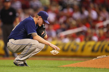 ST. LOUIS - SEPTEMBER 17: Starter Matt Latos #38 of the San Diego Padres regroups after giving up consecutive hits against the St. Louis Cardinals at Busch Stadium on September 17, 2010 in St. Louis, Missouri.  (Photo by Dilip Vishwanat/Getty Images)