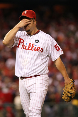 PHILADELPHIA - OCTOBER 19:  Starting pitcher Joe Blanton #56 of the Philadelphia Phillies wipes his forehead as he walks back to the dugout at the end of the top of the fourth inning against the Los Angeles Dodgers in Game Four of the NLCS during the 2009