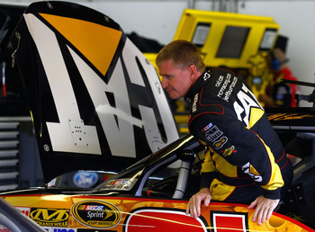 LOUDON, NH - SEPTEMBER 18:  Jeff Burton, driver of the #31 Caterpillar Chevrolet, climbs out of his car in the garage during practice for the NASCAR Sprint Cup Series Sylvania 300 at New Hampshire Motor Speedway on September 18, 2010 in Loudon, New Hampsh