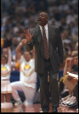 22 Mar 1997:  Coach Clem Haskins of the Minnesota Golden Gophers gives instructions to his players during a playoff game against the University of California at Los Angeles Bruins.  Minnesota won the game 80 - 72. Mandatory Credit: Stephen Dunn  /Allsport