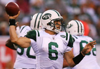 EAST RUTHERFORD, NJ - SEPTEMBER 19:  Mark Sanchez #6 of the New York Jets drops back against the New England Patriots at the New Meadowlands Stadium on September 19, 2010 in East Rutherford, New Jersey. The Jets defeated the Patriots 28 - 14.  (Photo by A