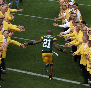GREEN BAY, WI - SEPTEMBER 19: Charles Woodson #21 of the Green Bay Packers runs onto the field during player introductions before a game against the Buffalo Bills at Lambeau Field on September 19, 2010 in Green Bay, Wisconsin. (Photo by Jonathan Daniel/Ge