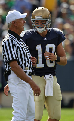 SOUTH BEND, IN - SEPTEMBER 04: Dayne Crist #10 of the Notre Dame Fighting Irish talks to a referee during a game against the Purdue Boilermakers at Notre Dame Stadium on September 4, 2010 in South Bend, Indiana. Notre Dame defeated Purdue 23-12.  (Photo b