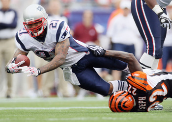FOXBORO, MA - SEPTEMBER 12:  Fred Taylor #21 of the New England Patriots is tackled by Johnathan Joseph #22 of the Cincinnati Bengals during the NFL season opener on September 12, 2010 at Gillette Stadium in Foxboro, Massachusetts. The Patriots defeated t