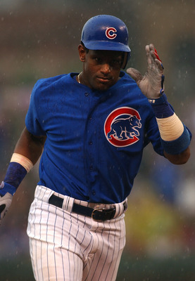 CHICAGO - JULY 21:  Sammy Sosa #21 of the Chicago Cubs runs the bases in the rain after hitting what proved to be the game-winning solo home run in the seventh inning against the Cincinnati Reds July 21, 2004 at Wrigley Field in Chicago, Illinois. The Cub