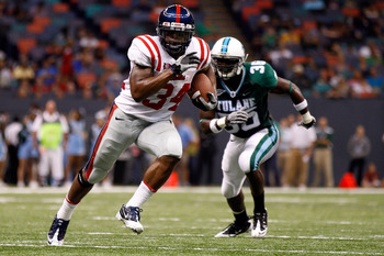 NEW ORLEANS - SEPTEMBER 11:  Brandon Bolden #34 of the Ole Miss Rebels runs past Dominique Robertson #36 of the Tulane Green Wave at the Louisiana Superdome on September 11, 2010 in New Orleans, Louisiana.  (Photo by Chris Graythen/Getty Images)