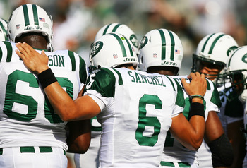 EAST RUTHERFORD, NJ - SEPTEMBER 19:  Mark Sanchez #6 of the New York Jets huddles with his team before a game against the New England Patriots at the New Meadowlands Stadium on September 19, 2010 in East Rutherford, New Jersey.  (Photo by Andrew Burton/Ge