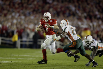 3 Jan 2002:  Quarterback Eric Crouch #7 of Nebraska scrambles against the defense of James Lewis #23 of Miami during the Rose Bowl National Championship game at the Rose Bowl in Pasadena, California.  Miami won the game 37-14, winning the BCS and the Nati