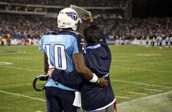 NASHVILLE, TN - NOVEMBER 29:  Vince Young #10 and head coach Jeff Fisher of the Tennessee Titans share a moment during their game against the Arizona Cardinals at LP Field on November 29, 2009 in Nashville, Tennessee.  (Photo by Streeter Lecka/Getty Image