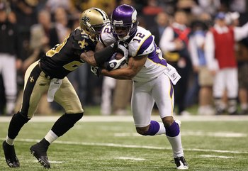 NEW ORLEANS - JANUARY 24:  Percy Harvin #12 of the Minnesota Vikings returns a punt against Randall Gay #20 of the New Orleans Saints during the NFC Championship Game at the Louisiana Superdome on January 24, 2010 in New Orleans, Louisiana. The Saints won