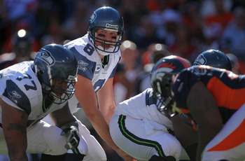 DENVER - SEPTEMBER 19:  Quarterback Matt Hasselbeck #8 of the Seattle Seahawks prepares to take the snap from center Chris Spencer #65 against the Denver Broncos at INVESCO Field at Mile High on September 19, 2010 in Denver, Colorado. The Broncos defeated