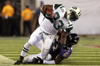 EAST RUTHERFORD, NJ - SEPTEMBER 13:  Shonn Greene #23 of the New York Jets gets tackeled by Ray Lewis #52 of the Baltimore Ravens during their home opener at the New Meadowlands Stadium on September 13, 2010 in East Rutherford, New Jersey.  (Photo by Jim