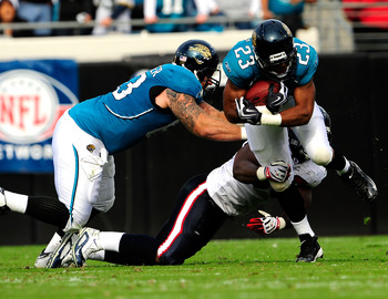 JACKSONVILLE, FL - DECEMBER 06:  Rashad Jennings #23 of the Jacksonville Jaguars runs for yardage during the game against the Houston Texans at Jacksonville Municipal Stadium on December 6, 2009 in Jacksonville, Florida.  (Photo by Sam Greenwood/Getty Ima