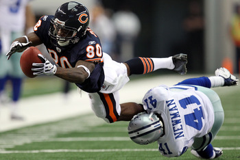 ARLINGTON, TX - SEPTEMBER 19:  Wide receiver Earl Bennett #80 of the Chicago Bears dives for extra yardage while tackled by Terence Newman #41 of the Dallas Cowboys at Cowboys Stadium on September 19, 2010 in Arlington, Texas.  (Photo by Ronald Martinez/G