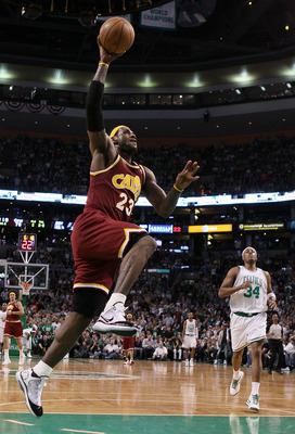 BOSTON - MAY 09:  LeBron James #23 of the Cleveland Cavaliers has a break away basket as Paul Pierce #34 of the Boston Celtics defends during Game Four of the Eastern Conference Semifinals of the 2010 NBA playoffs at TD Garden on May 9, 2010 in Boston, Ma