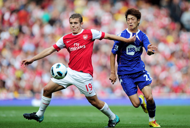 LONDON, ENGLAND - SEPTEMBER 11:  Jack Wilshere of Arsenal battles with Lee Chung-Yong of Bolton during the Barclays Premier League match between Arsenal and Bolton Wanderers at The Emirates Stadium on September 11, 2010 in London, England.  (Photo by Jami