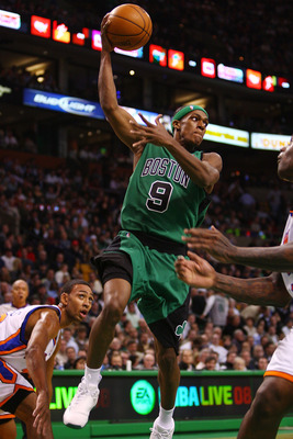 BOSTON - NOVEMBER 29:  Rajon Rondo #9 of the Boston Celtics passes the ball as Jared Jeffries #20 of the New York Knicks defends at the TD Banknorth Garden November 29, 2007 in Boston, Massachusetts.  NOTE TO USER: User expressly acknowledges and agrees t