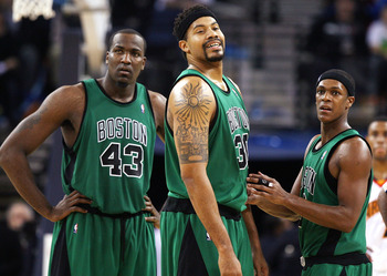 OAKLAND, CA - DECEMBER 28: Rasheed Wallace #30 of the Boston Celtics looks on with teammates Kendrick Perkins #43 and Rajon Rondo #9 against the Golden State Warriors during an NBA game at Oracle Arena on December 28, 2009 in Oakland, California. NOTE TO
